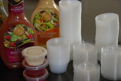 Portable and disposable containers for salad dressing used with my salad-in-a-jar