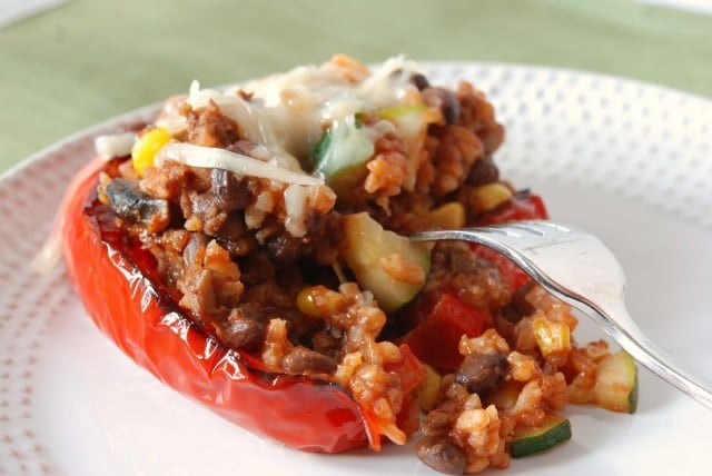 Southwestern Roasted Stuffed Peppers feature lots of veggies, rice and sausage.