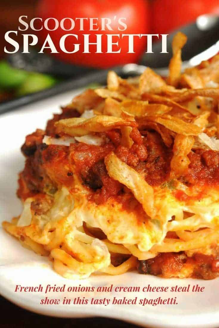 Baked Spaghetti layered with seasoned cream cheese and topped with french fried onions