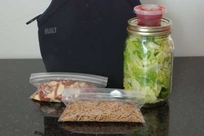 salad-in-a-jar with Fiber One, almonds and sun-dried tomatoes, and salad dressing