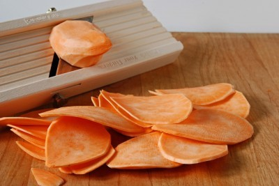 slicing raw sweet potatoes