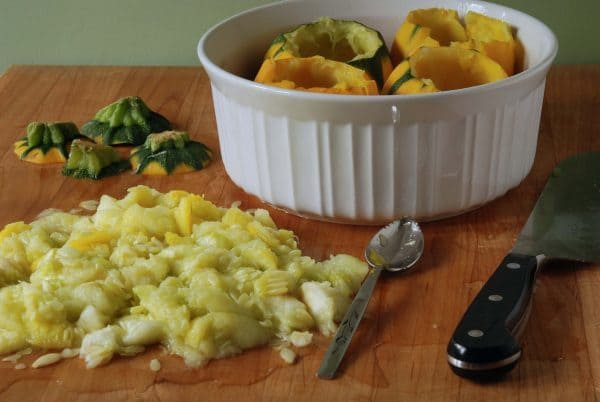 Sausage-Stuffed 8-Ball Squash -- scooping out squash