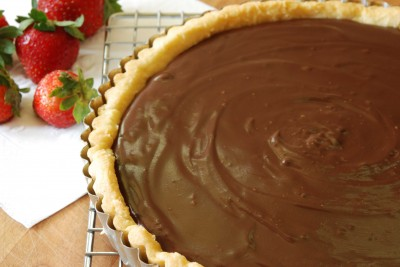 whole choc crunch tart on rack