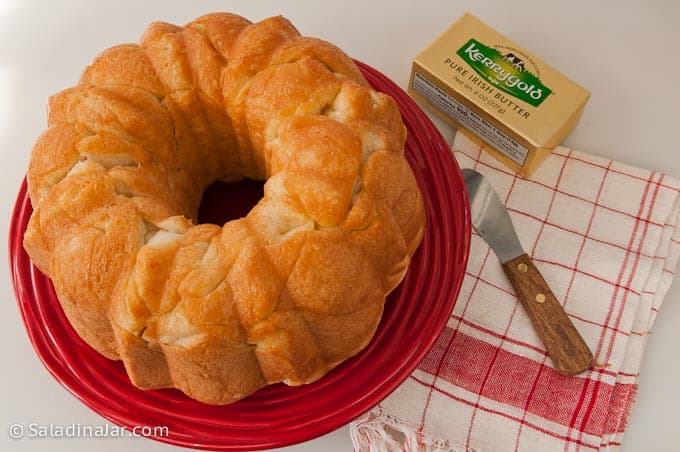 Baked Monkey Bread on a plate next to butter and butter knife