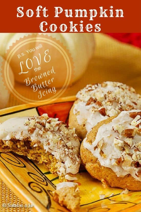 iced pumpkin cookies with pecans on top