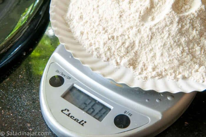 weighing flour for bread dough