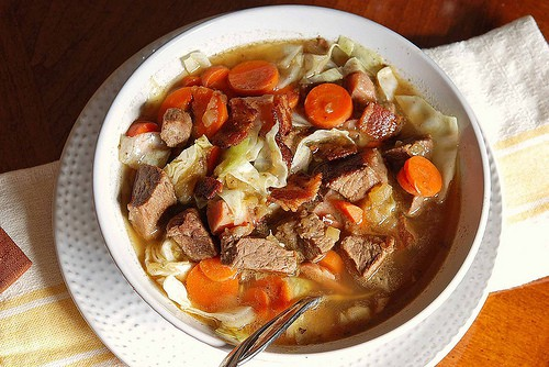 Beef-broth based soup with beef stew meat, ham, bacon, carrots, cabbage and apples