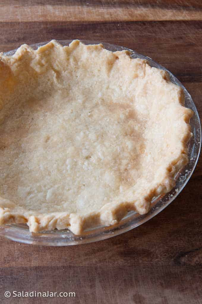 baked pie crust after using a chain inside during pre-bake.