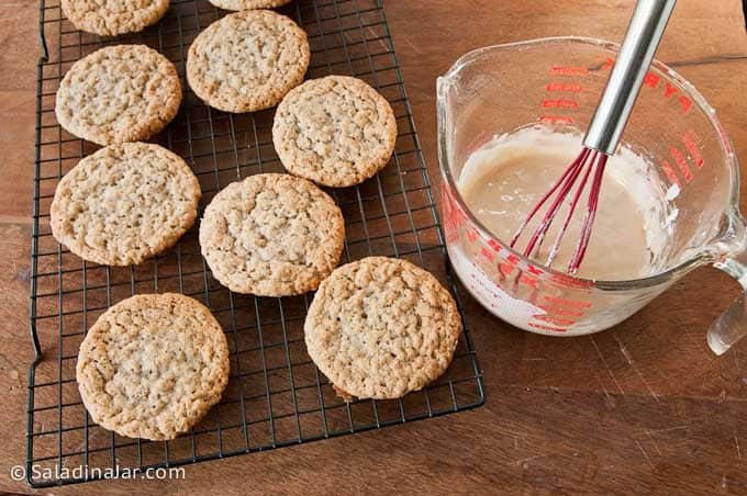 unfrosted oatmeal cookies ready for coffee-flavored glaze