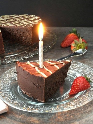 This Glazed Fudge Birthday Cake is a one-layer chocolate cake mixed in a food processor. The glaze is rich but not too sweet.