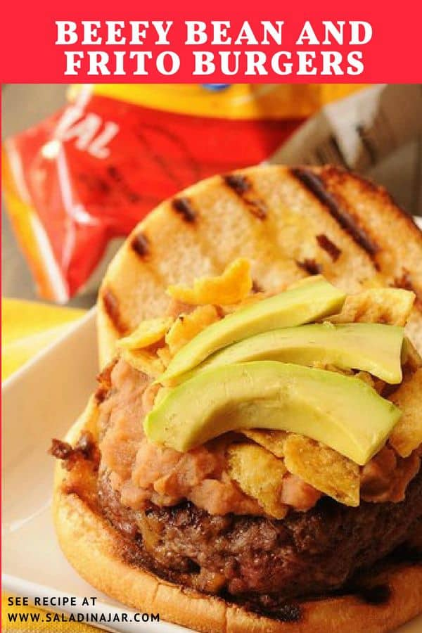 A hamburger topped with refried beans, Fritos, and avocados in the style once served at EZ's.