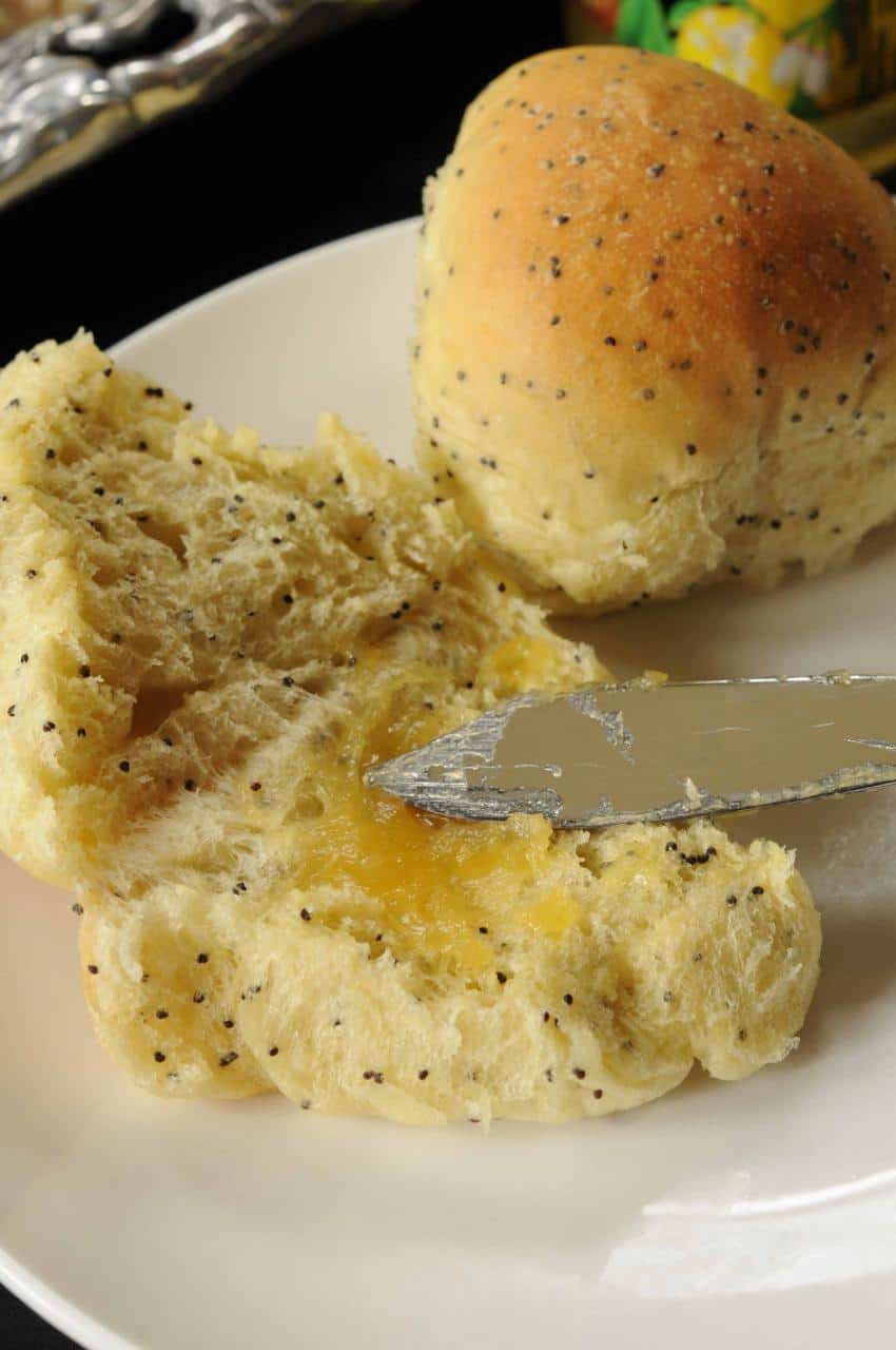Poppy Seed Rolls split open with lemon curd on the side