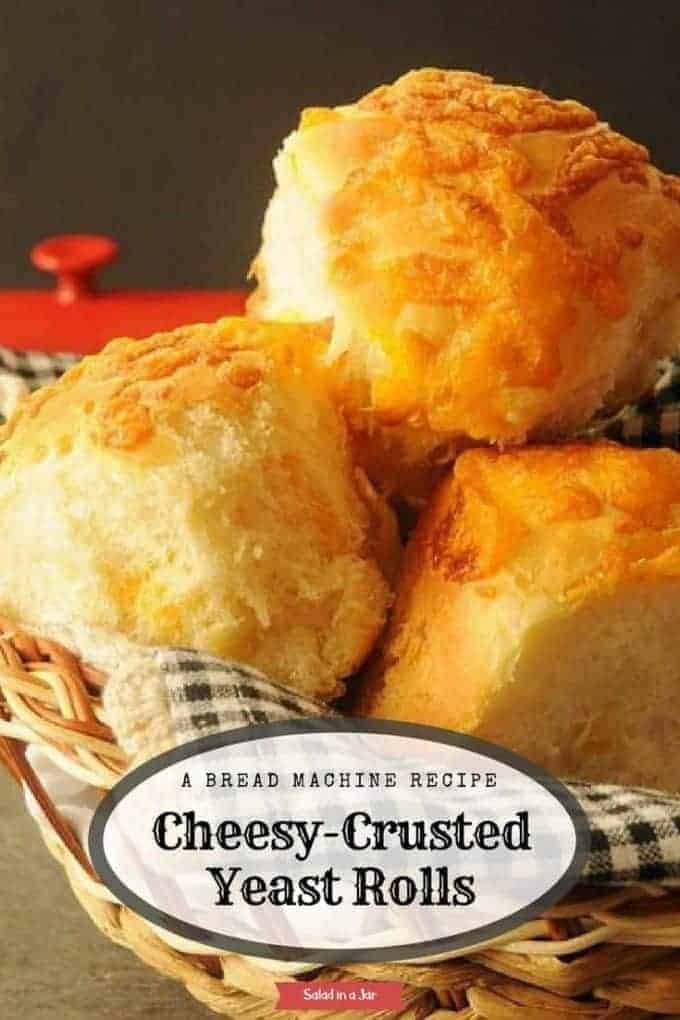 Cheesy-Crusted Yeast Rolls have cheddar cheese on the inside and outside--a bread machine recipe that makes any holiday or celebration special