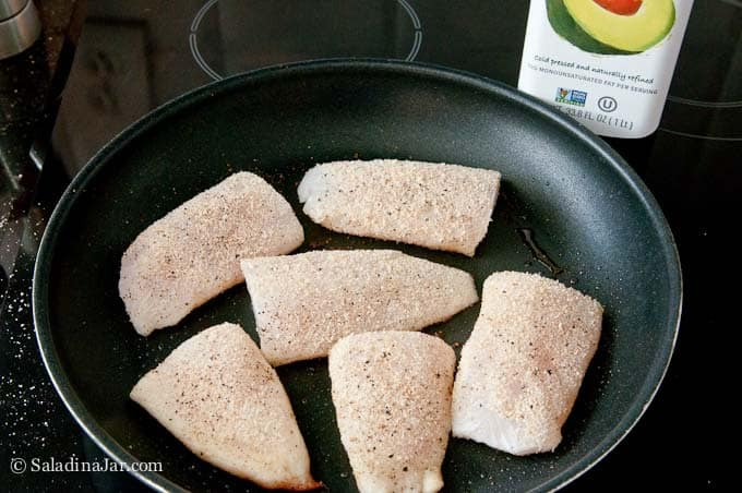 Breaded fish in skillet
