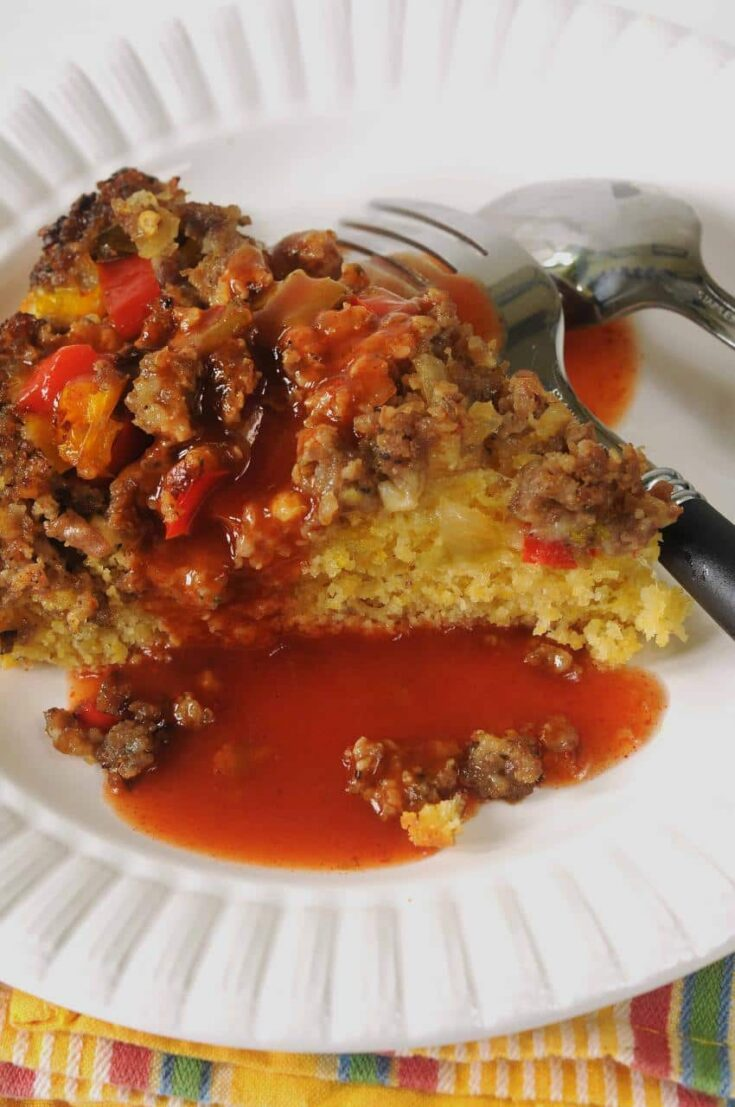 Layer cornbread batter on top of cooked sausage and peppers. Fun to eat.