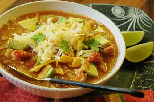A tomato and stock-based tortilla soup with finely chopped tortillas added while cooking as a thickener.