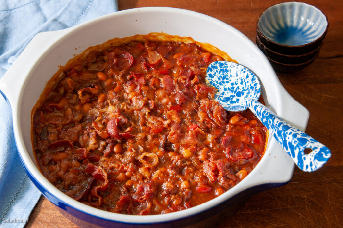 Baked beans with sausage and ground beef in a serving dish after baking