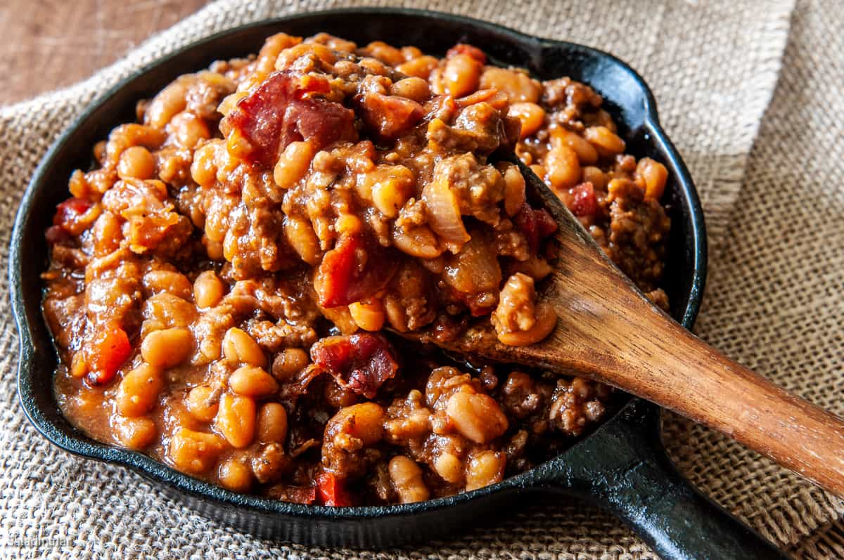 Baked Beans with ground beef and sausage in a skillet--ready to eat.