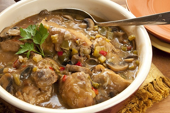 CAJUN CHICKEN AND MUSHROOMS--in serving dish with serving spoon
