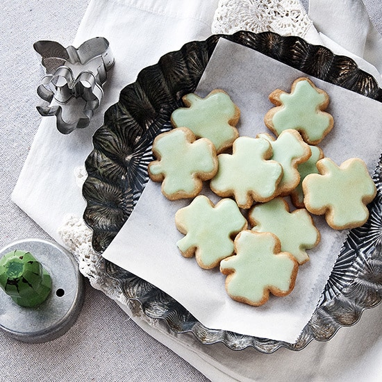 Shamrock Shortbread Cookies - Plate of frosted green shamrock shortbread cookies