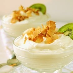 Plain Greek (or regular) yogurt flavored with cream of coconut, candied ginger and toasted shaved coconut.