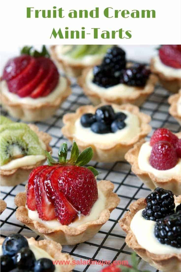 Shortbread-crusted tarts filled with a light, creamy custard filling and topped with fresh fruit of your choice