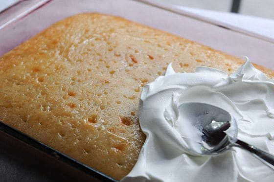 Amie's Triple Coconut Cake--spreading topping on cake