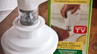 Using a Handheld Device to Vacuum-Pack Lettuce