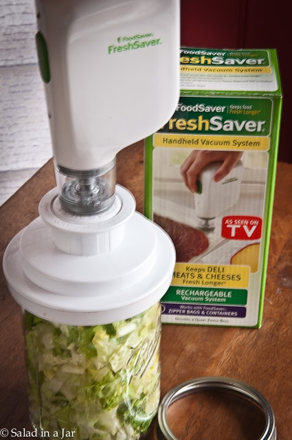 Handheld Vacuum-Pack Machine to Seal Salad in a Jar