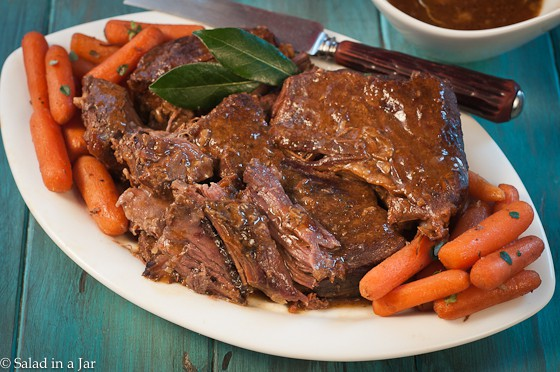 Simple Pot Roast- on serving plate with carrots.