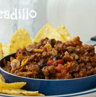 Picadillo in a small skillet with chips