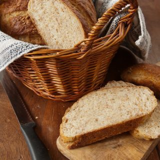 A nubbly, crunchy, and earthy-tasting white bread starring cracked whole wheat berries--a bread machine recipe to bake in your conventional oven.