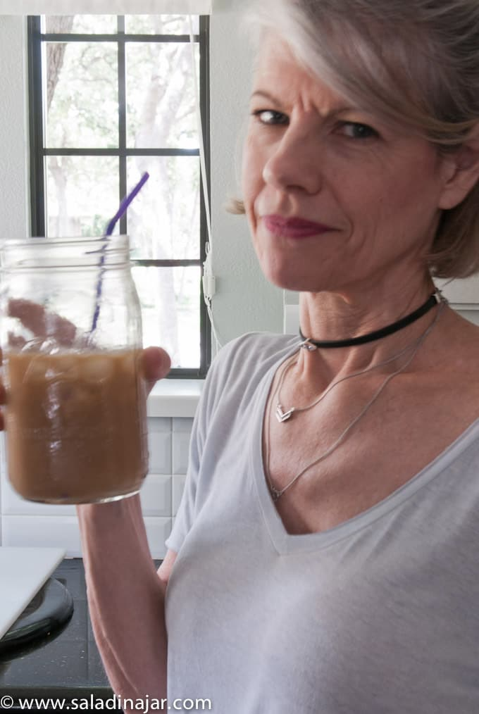 blog owner drinking a latte