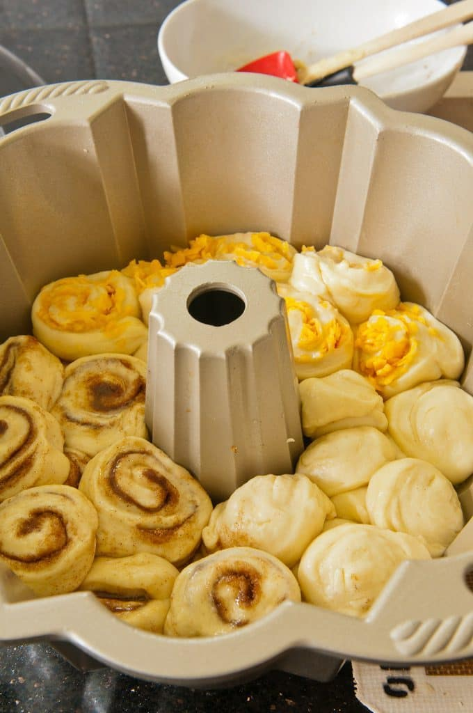three different flavors of raw dough for the Pull-Apart recipe is shown in bundt pan