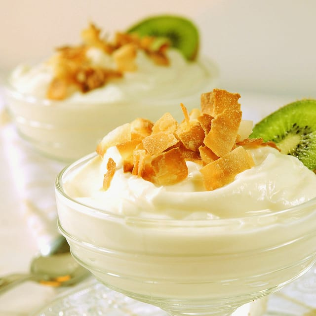 Coconut and Ginger Yogurt garnished with shaved coconut and sliced kiwi