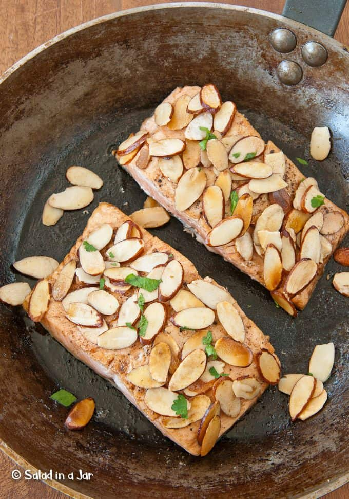 almond-covered salmon in a skillet