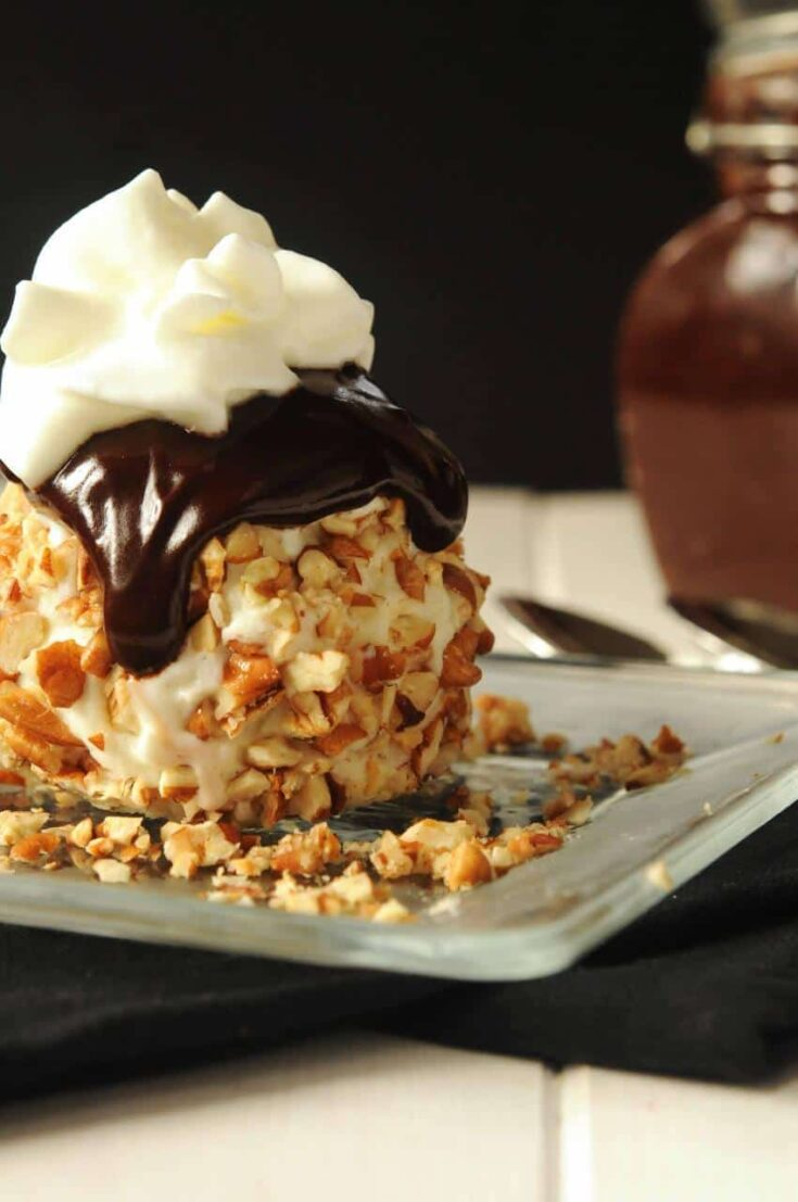 Ice cream balls rolled in toasted pecans and served with hot fudge sauce