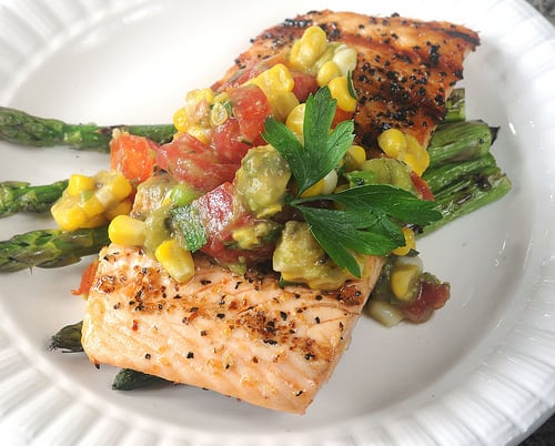 Warm grilled salmon served with summertime-fresh corn, tomato and avocado relish.