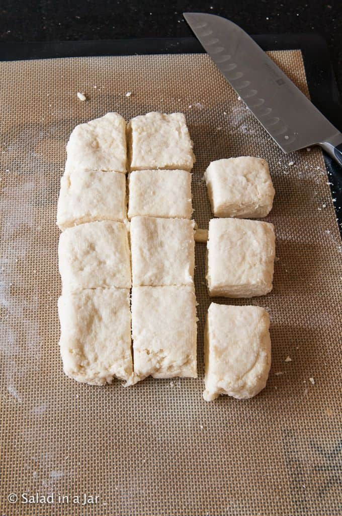 cutting dough into biscuits