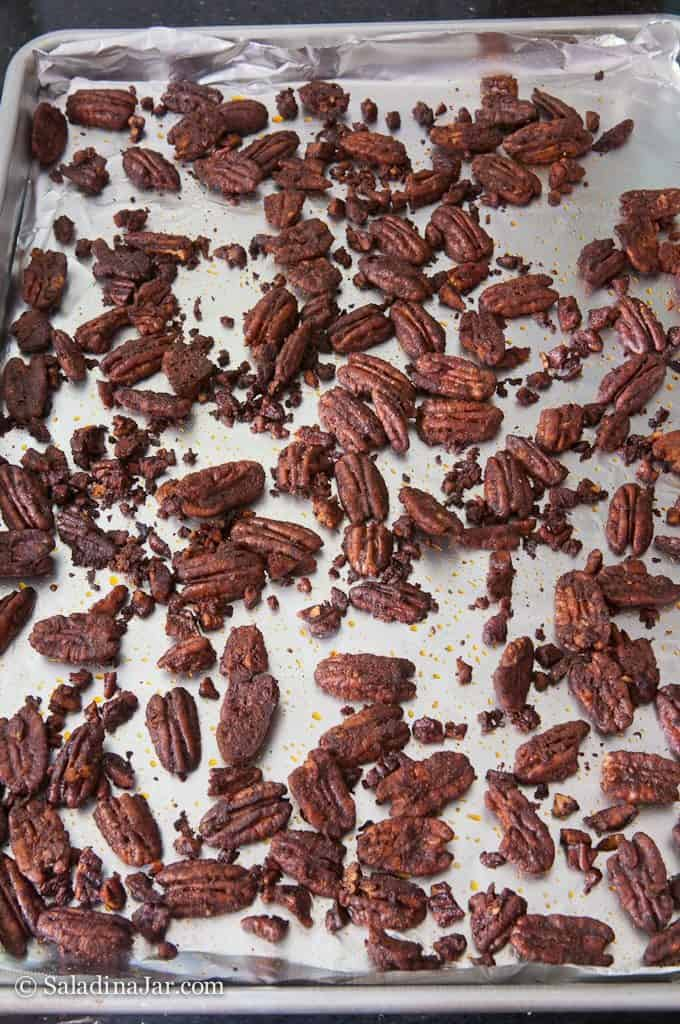 Baked spicy pecans on cookie sheet