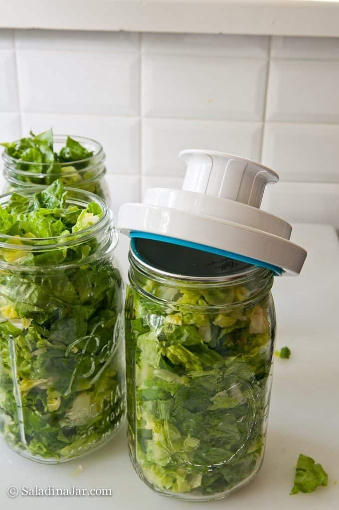 Vacuum-pack Lettuce to Prolong Freshness-- placing vacuum-pack lid adapter on jar