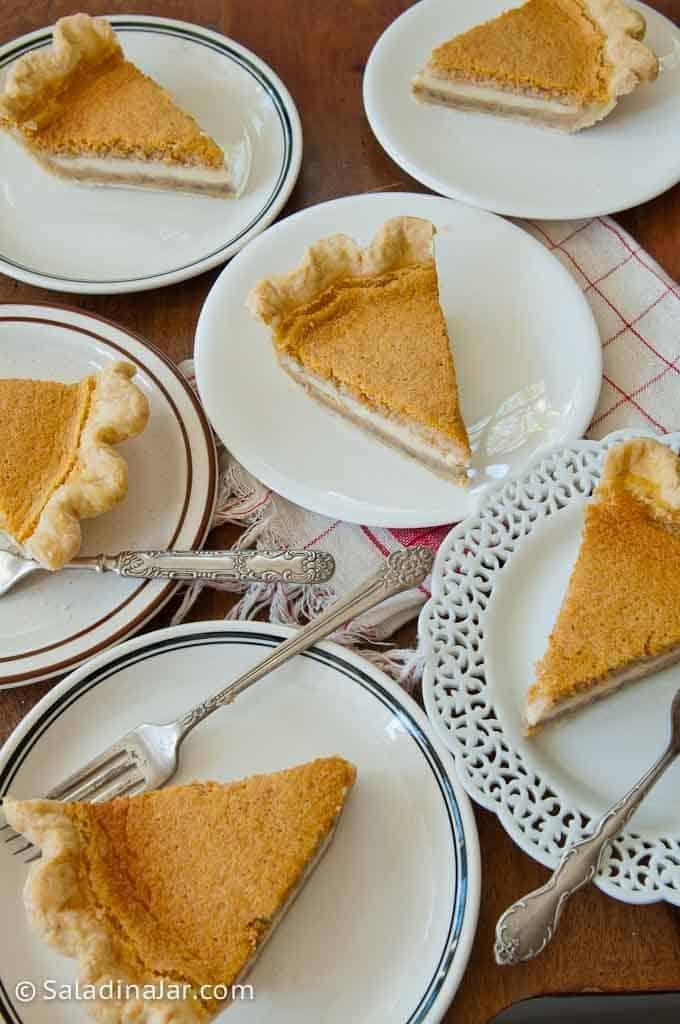 Slices of layered pumpkin custard pie