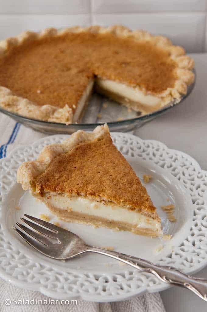Grandma's Magical Layered Custard Pumpkin Pie Slice taken from whole pie.