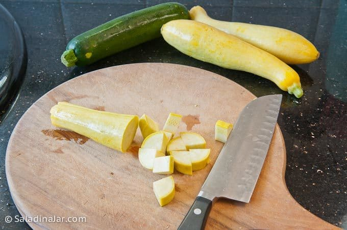 Cutting up yellow squash