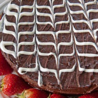 glazed fudge cake garnished with strawberries