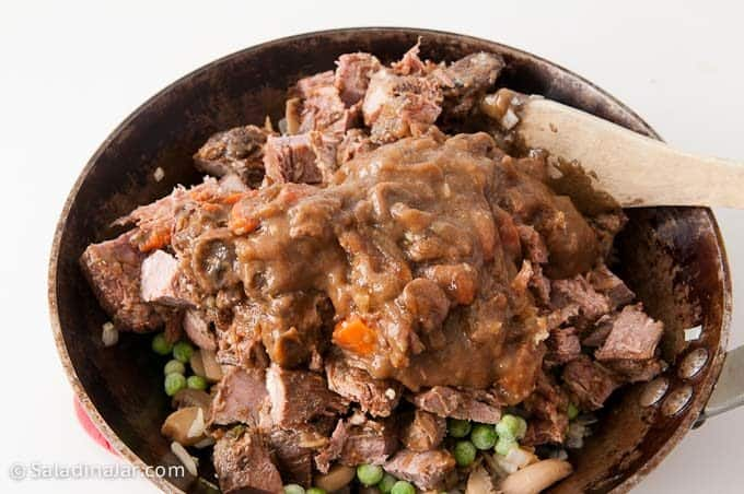 adding beef for meat layer of shepherd's pie