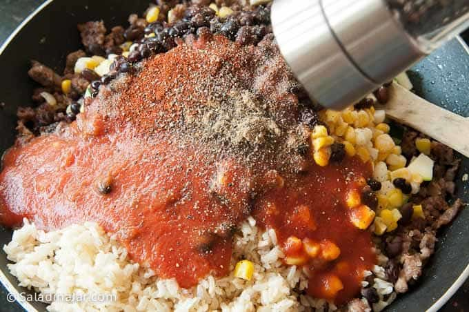 sauce and seasonings added to skillet