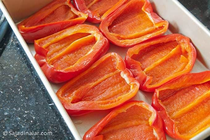 baked red peppers, flipped over and ready for filling