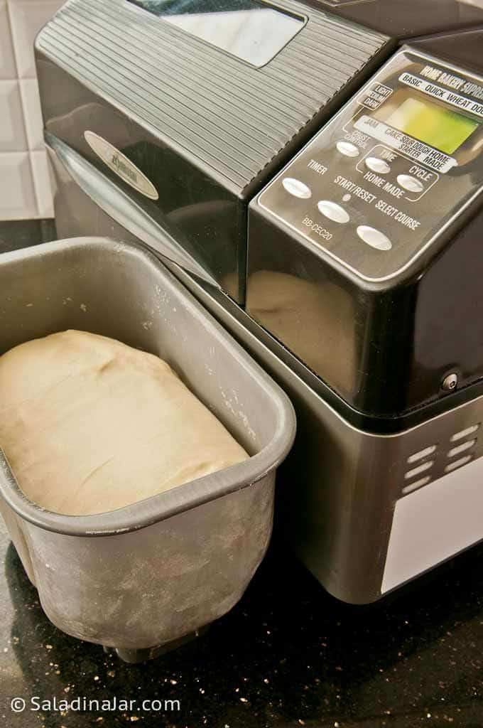 bread dough beside bread machine--Reasons Why I'm in Love With My Bread Maker Machine