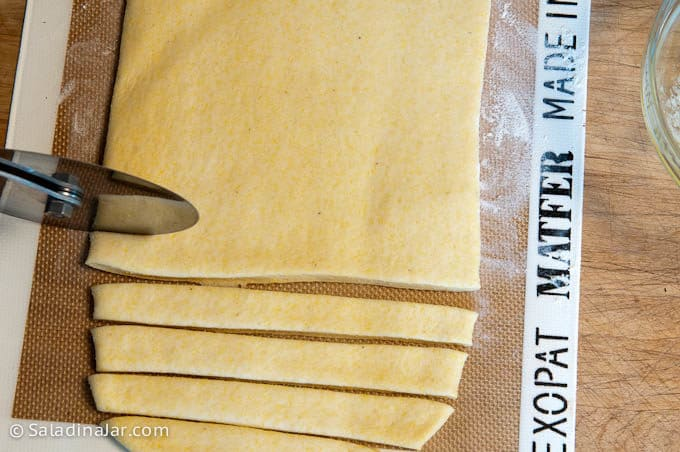 cutting dough into strips